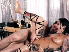 Oiled girl Joanna Angel wants to moan while a horny guy bangs her