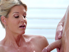 Oiled cutie India Summer massages a dick with her pussy
