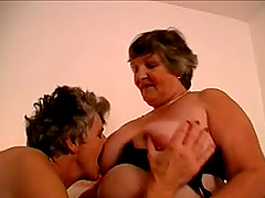 Two fat grannies toy their asses and pussies in a bedroom